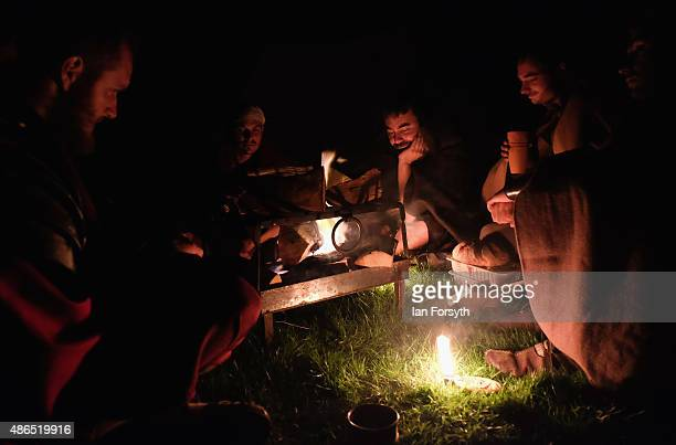 Roman soldiers from the Italian reenactment group Legio 1 Italica sit around their camp fires at night as they take part in a weekend of authentic...