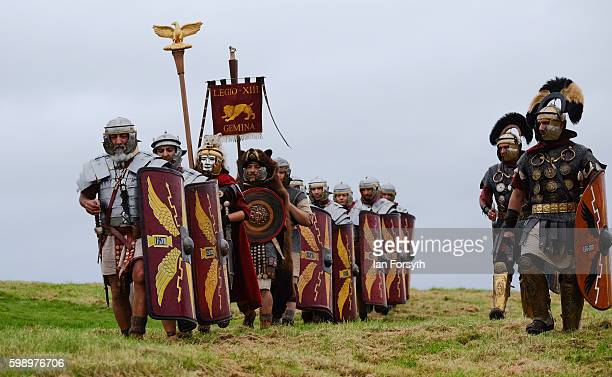 Roman soldiers march across open countryside as the lives of Roman Legionnaires are reenacted during the Hadrian's Wall Live event at Housesteads...