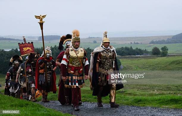 Roman soldiers march across open ground as the lives of Roman Legionnaires are reenacted during the Hadrian's Wall Live event at Housesteads Roman...