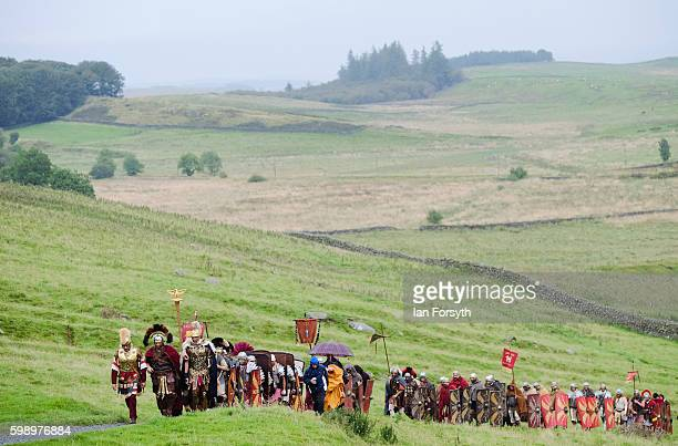 Roman soldiers march across the hills of Northumberland towards Houseteads Roman fort during the Hadrian's Wall Live event on September 3 2016 in...