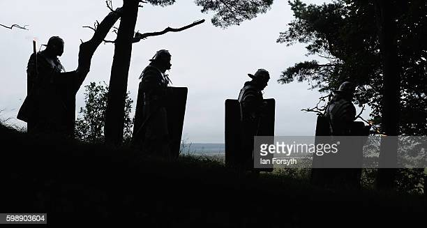 Roman soldiers patrol through woods along Hadrian's Wall as the lives of Roman Legionnaires are reenacted during the Hadrian's Wall Live event at...