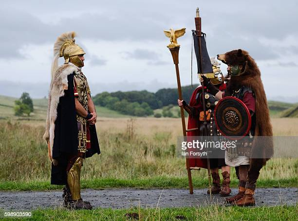 Roman soldiers prepare to march as the lives of Roman Legionnaires are reenacted during the Hadrian's Wall Live event at Housesteads Roman fort on...