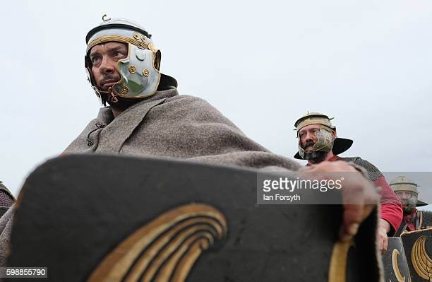Roman soldiers prepare to march onto the battlefield as the lives of Roman Legionnaires are reenacted during the Hadrian's Wall Live event at...