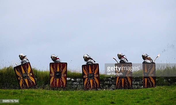 Roman soldiers take part in an evening patrol as the lives of Roman Legionnaires are reenacted during the Hadrian's Wall Live event at Housesteads...