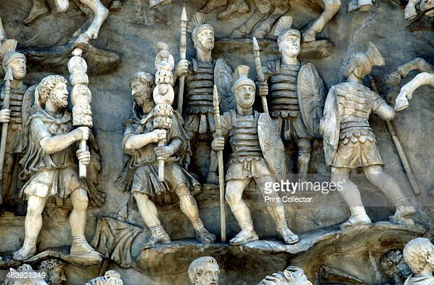 Roman soldiers taking part in decursio ritual circling of funeral pyre c180196 Detail of a relief from the Antonine Column Rome erected c180196 by...