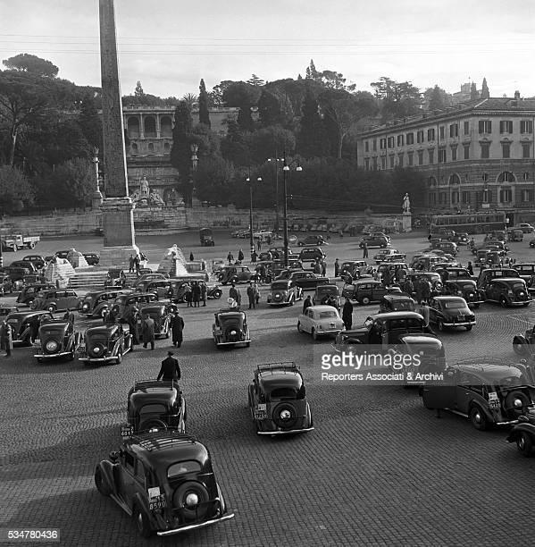 Roman taxi drivers demonstrating in Piazza del Popolo Rome 1956