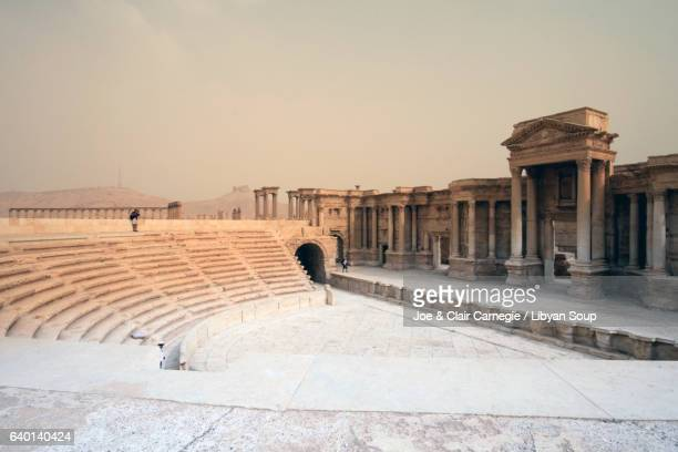 roman theater and tetrapylon. palmyra, syria. - isil militant group stock photos and pictures