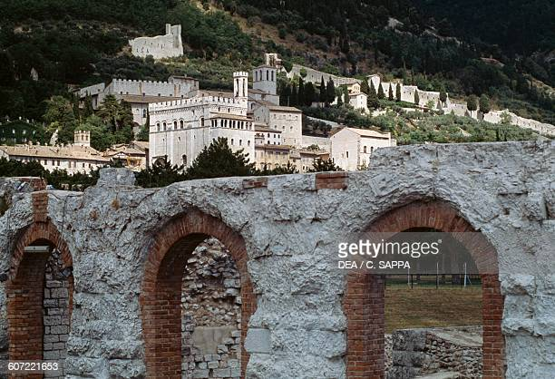 Roman theatre, 1st century, with the Consuls palace in the background, 1332-1349, Piazza Grande, Gubbio, Umbria, Italy.