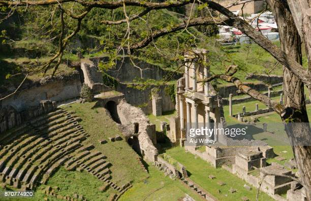 roman theatre in historic volterra - volterra stock photos and pictures