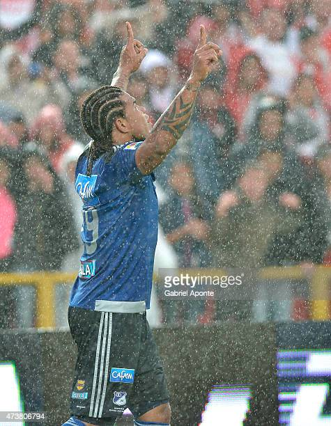 Roman Torres of Millonarios celebrates after scoring the second goal of his team during a match between Independiente Santa Fe and Millonarios as...