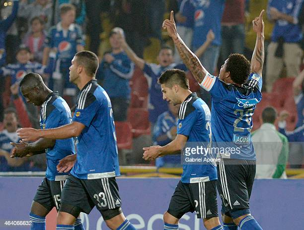 Roman Torres of Millonarios celebrates with teammates after scoring the first goal of his team during a match between Millonarios and Cortulua as...
