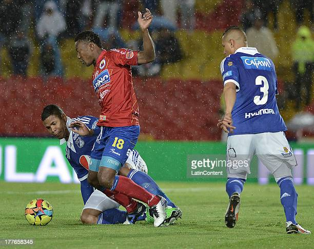 Roman Torres of Millonarios struggles for the ball with Mauricio Mina of Pasto during a match between Millonarios and Deportivo Pasto as part of the...