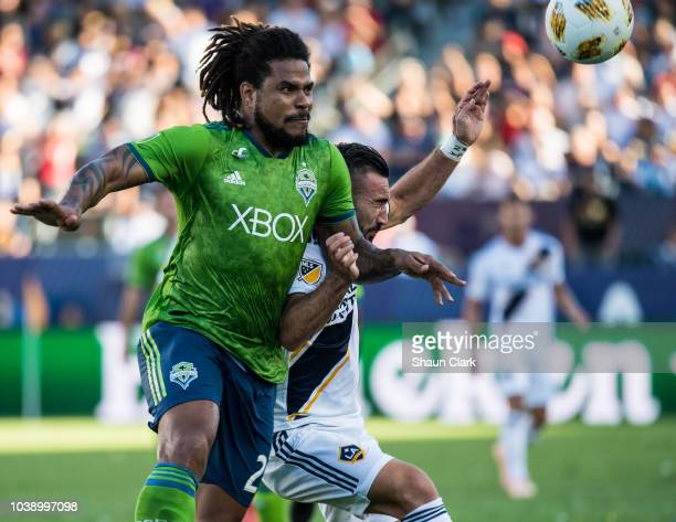 Roman Torres of Seattle Sounders defends against Romain Alessandrini of Los Angeles Galaxy during the Los Angeles Galaxy's MLS match against Seattle...
