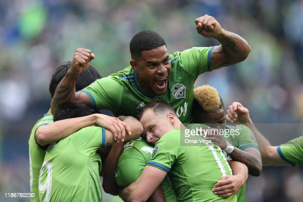 Roman Torres of Seattle Sounders FC celebrates the 1st goal with his teammates during the match between Toronto FC and Seattle Sounders as part of...