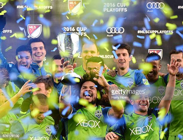 Roman Torres of Seattle Sounders holds up the MLS Western Conference trophy after a 10 victory over the Colorado Rapids at Dick's Sporting Goods Park...