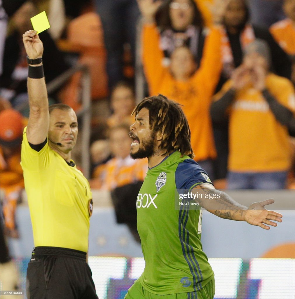 Roman Torres #29 of Seattle Sounders reacts as referee Chris Penso issues him a yellow card in the second half against the Houston Dynamo at BBVA Compass Stadium on November 21, 2017 in Houston, Texas.