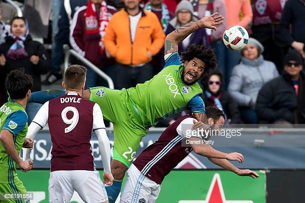 Roman Torres of the Seattle Sounders and Shkelzen Gashi of the Colorado Rapids go down after diving for a ball during the first half of the second...