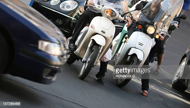 Roman traffic with scooters, Rome Italy