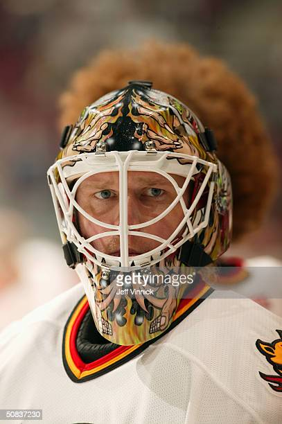 Roman Turek of the Calgary Flames looks on during warm up prior to the game against the Vancouver Canucks in the first round of the 2004 NHL Stanley...