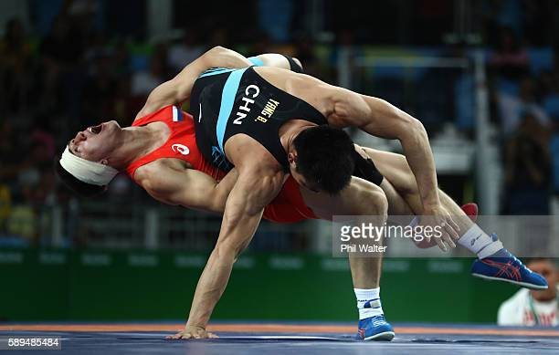 Roman Vlasov of Russia competes against Bin Yang of China during the Men's 75 kg GrecoRoman Wrestling quarterfinals on Day 9 of the Rio 2016 Olympic...