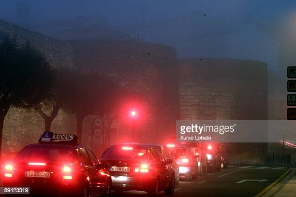Roman Wall of Lugo with fog The wall is the most impressive testimony left by the Romans in Galicia A city wall two thousand years old with a...