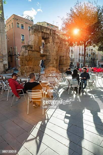 roman walls in roman forum squar - tarragona stock photos and pictures