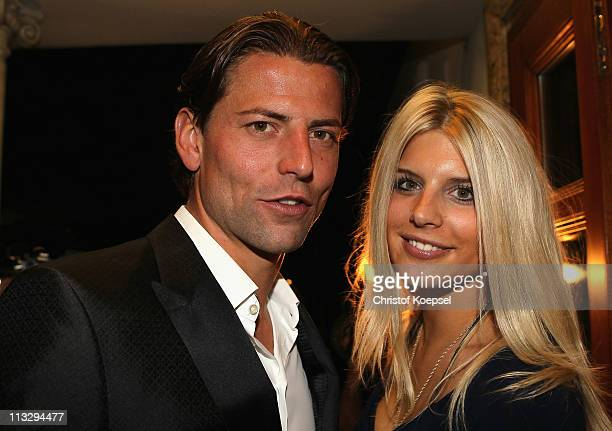Roman Weidenfeller and his girlfriend Lisa pose before celebrate winning the German Championships at a restaurant on April 30 2011 in Dortmund Germany