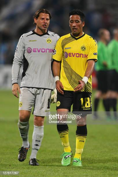 Roman Weidenfeller and Lucas Barrios of Dortmund look dejected after losing 0-3 the UEFA Champions League group F match between Olympique Marseille...