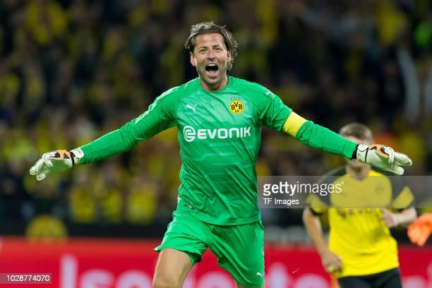 Roman Weidenfeller celebrates after scoring his team`s third goal during the Roman Weidenfeller Farewell Match between BVB Allstars and Roman and...
