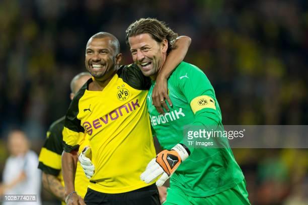 Roman Weidenfeller celebrates after scoring his team`s third goal with Philipp Degen of Borussia Dortmund Allstars during the Roman Weidenfeller...