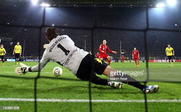 Roman Weidenfeller goalkeeper of Dortmund saves the penalty shoot of Arjen Robben of Muenchen during the Bundesliga match between Borussia Dortmund...