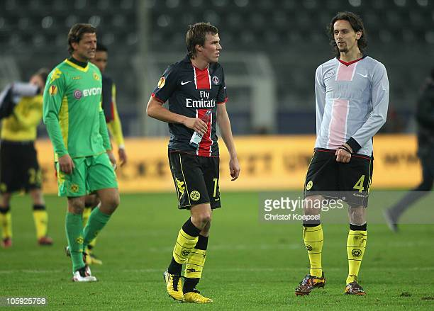 Roman Weidenfeller Kevin Grosskreutz of Dortmund and Mats Hummels look dejected after the UEFA Europa League group J match between Borussia Dortmund...