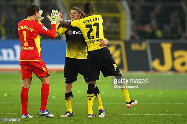Roman Weidenfeller Lukasz Piszczek and Felipe Santana of Dortmund celebrate the 20 victory after the Bundesliga match between Borussia Dortmund and...