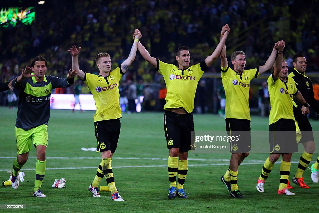 Roman Weidenfeller, Marco Reus, Sebastian Kehl, Oliver Kirch and Mario Goetze of Dortmund celebrate the 2-1 victory after the Bundesliga match between Borussia Dortmund and Werder Bremen at Signal Iduna Park on August 24, 2012 in Dortmund, Germany.