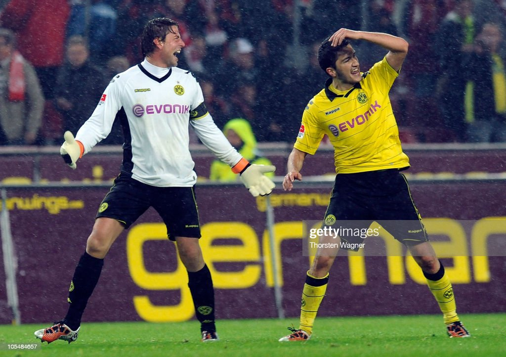 Roman Weidenfeller (L) of Dortmund and his team mate Nuri Sahin (R) celebrate after winning the Bundesliga match between 1.FC Koeln and Borussia Dortmund at RheinEnergieStadion on October 15, 2010 in Cologne, Germany.