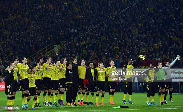 Roman Weidenfeller of Dortmund celebrates with his team mates after winning the Bundesliga match between Borussia Dortmund and Bayern Muenchen at...