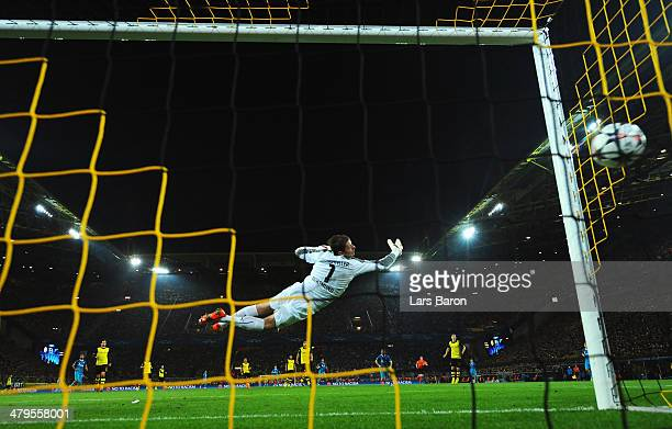 Roman Weidenfeller of Dortmund fails to stop a shot by Hulk of Zenit as he scores the opening goal during the UEFA Champions League round of 16,...