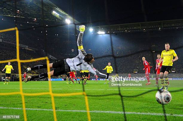 Roman Weidenfeller of Dortmund fails to stop a shot by Mario Goetze of Munich during the Bundesliga match between Borussia Dortmund and FC Bayern...