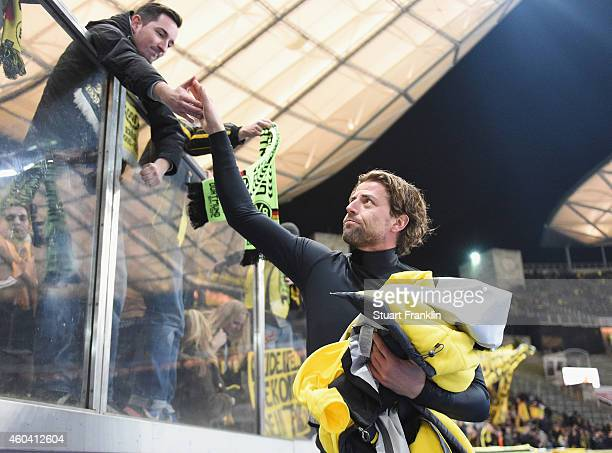Roman Weidenfeller of Dortmund greets fans after the Bundesliga match between Hertha BSC and Borussia Dortmund at Olympiastadion on December 13 2014...