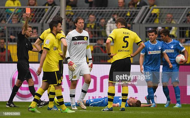 Roman Weidenfeller of Dortmund is shown the red card by referee Doctor Jochen Drees during the Bundesliga match between Borussia Dortmund and TSG...