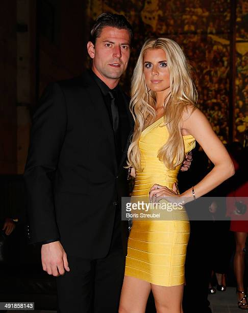 Roman Weidenfeller of Dortmund pose with his girlfriend Lisa Rossenbach during the Borussia Dortmund Champions party after the DFB Cup final 2014 at...