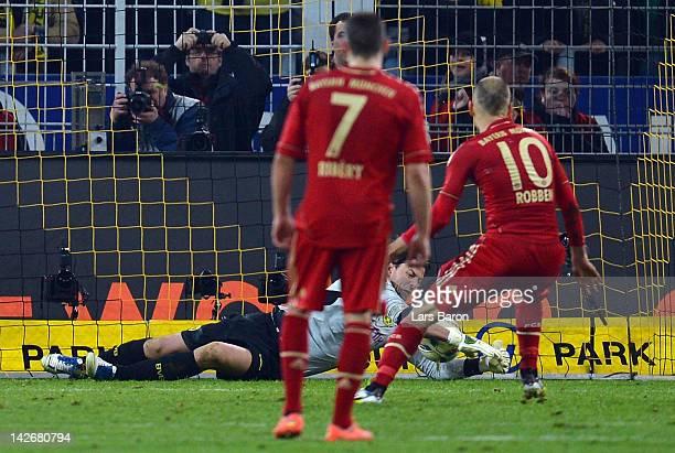 Roman Weidenfeller of Dortmund saves the penalty of Arjen Robben of Muenchen during the Bundesliga match between Borussia Dortmund and Bayern...