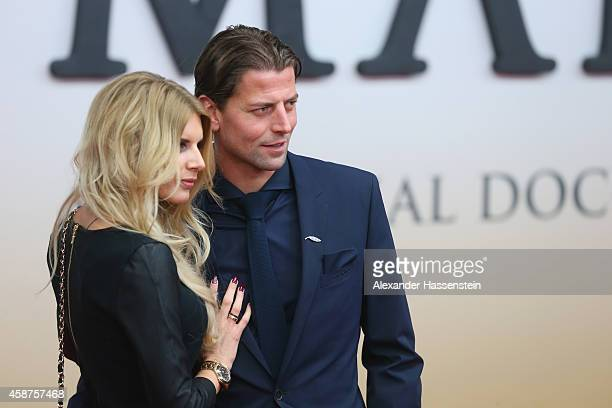 Roman Weidenfeller of the German national football team arrives with Lisa Rossenbach for the movie premiere 'Die Mannschaft' at Sony Center Berlin on...