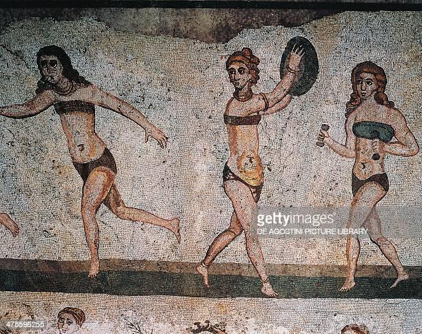Roman women wearing bikinis doing different sports mosaic Chamber of the ten maidens Villa del Casale Piazza Armerina Sicily Detail Roman...