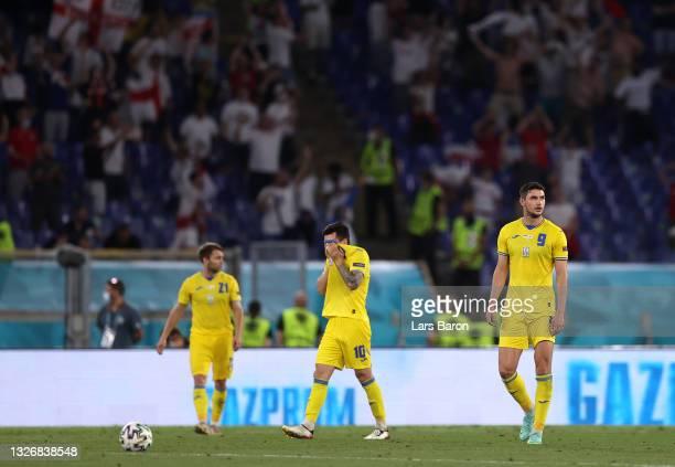 Roman Yaremchuk and Mykola Shaparenko of Ukraine look dejected after the England fourth goal scored by Jordan Henderson during the UEFA Euro 2020...