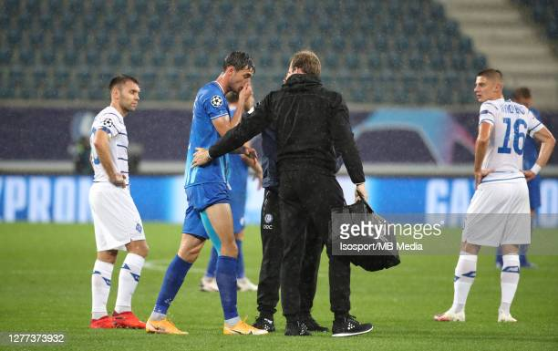 Roman Yaremchuk of KAA Gent suffers an injury during the UEFA Champions League PlayOff first leg match between KAA Gent and Dynamo Kyiv at Ghelamco...