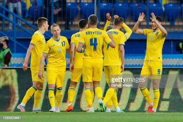 Roman Yaremchuk of Ukraine celebrates after scoring his team's third goal with teammates during the international friendly match between Ukraine and...