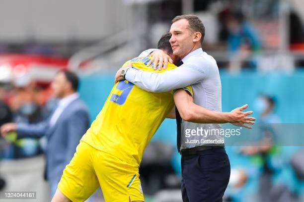 Roman Yaremchuk of Ukraine celebrates with Andriy Shevchenko, Head Coach of Ukraine after scoring their side's second goal during the UEFA Euro 2020...