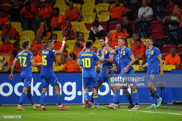 Roman Yaremchuk of Ukraine celebrates with team mates after scoring their side's second goal during the UEFA Euro 2020 Championship Group C match...