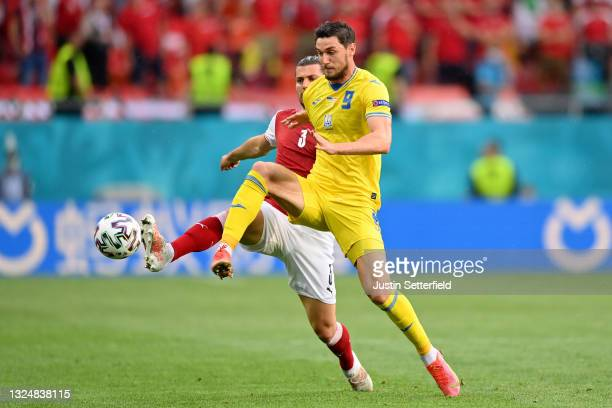 Roman Yaremchuk of Ukraine competes for the ball with Aleksandar Dragovic of Austria during the UEFA Euro 2020 Championship Group C match between...